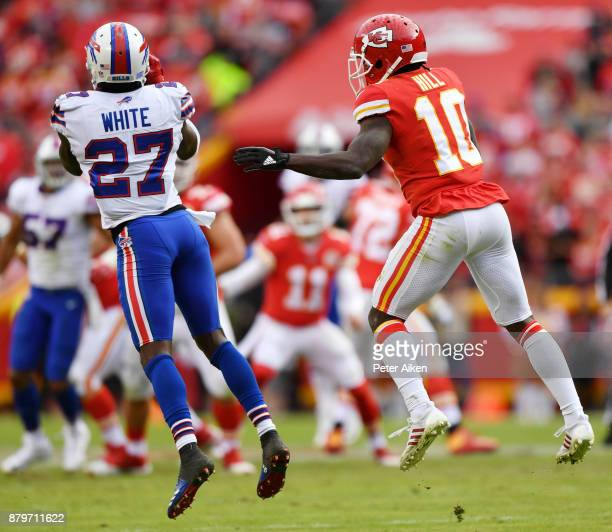 Cornerback Tre'Davious White of the Buffalo Bills intercepts a pass in front of wide receiver Tyreek Hill of the Kansas City Chiefs to seal the game...
