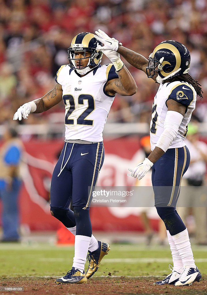 Cornerback <a gi-track='captionPersonalityLinkClicked' href=/galleries/search?phrase=Trumaine+Johnson&family=editorial&specificpeople=3915425 ng-click='$event.stopPropagation()'>Trumaine Johnson</a> #22 of the St. Louis Rams high fives Janoris Jenkins #21 after a defensive stop against the Arizona Cardinals during the NFL game at the University of Phoenix Stadium on November 25, 2012 in Glendale, Arizona. The Rams defeated the Cardinals 31-17.