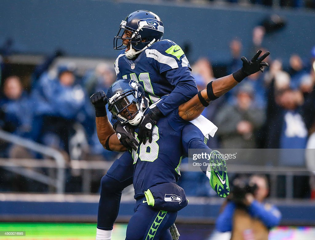 Cornerback <a gi-track='captionPersonalityLinkClicked' href=/galleries/search?phrase=Walter+Thurmond&family=editorial&specificpeople=3958038 ng-click='$event.stopPropagation()'>Walter Thurmond</a> #28 of the Seattle Seahawks is congratulated by defensive back Byron Maxwell #41 after returning an interception for a touchdown against the Minnesota Vikings at CenturyLink Field on November 17, 2013 in Seattle, Washington. The Seahawks defeated the Vikings 41-20.