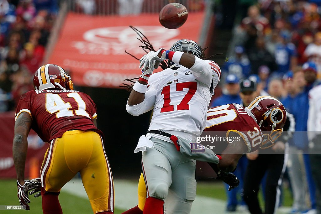 Cornerback Will Blackmon #41 of the Washington Redskins intercepts the ball after wide receiver Dwayne Harris #17 of the New York Giants tipped the ball in the first quarter at FedExField on November 29, 2015 in Landover, Maryland.