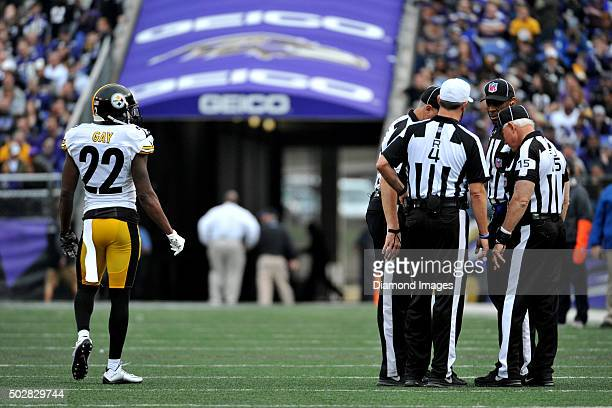 Cornerback William Gay of the Pittsburgh Steelers argues a call from behind the officials huddle during a game against the Baltimore Ravens on...
