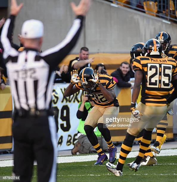 Cornerback William Gay of the Pittsburgh Steelers celebrates with teammates after returning an intercepted pass 33 yards for a touchdown during a...