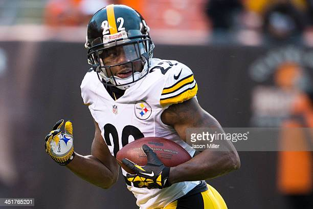 Cornerback William Gay of the Pittsburgh Steelers looks back for defenders as he runs in an interception for a touchdown during the second against...