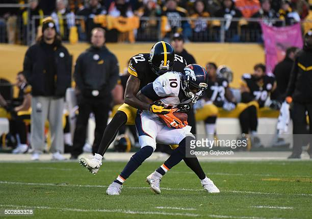 Cornerback William Gay of the Pittsburgh Steelers tackles wide receiver Emmanuel Sanders of the Denver Broncos during a game at Heinz Field on...