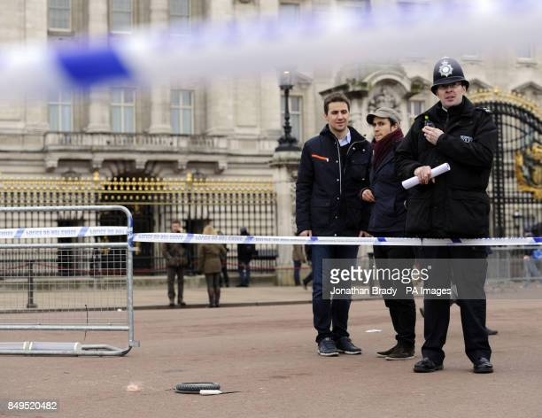 A cornered off area containing knives a hat and Taser wire outside Buckingham Palace in central London after a man was been Tasered by police