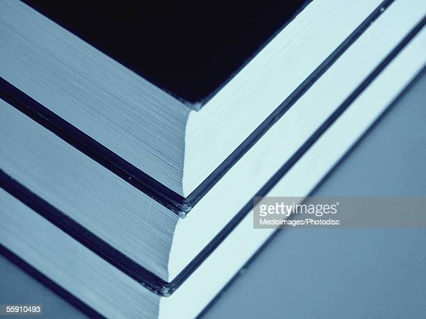 Corners of three books stacked on top of each other