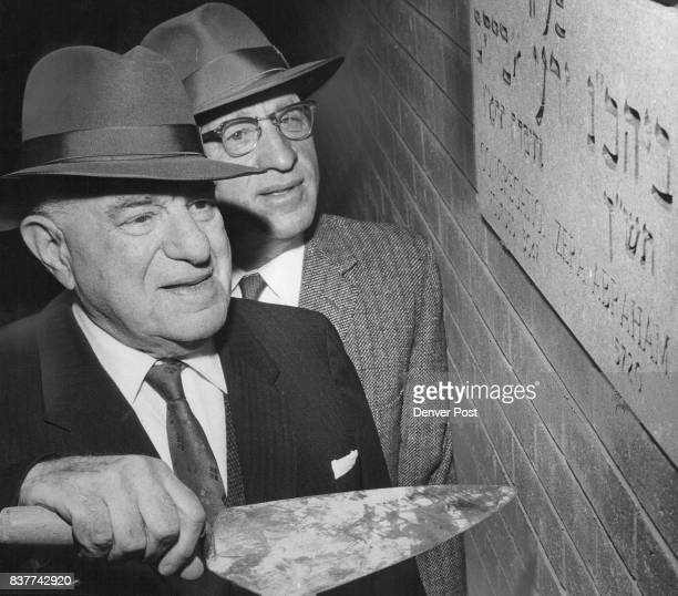 Cornerstone Laid at Denver Synagogue Adolph Kiesler Denver philanthropist and industrialist wields a trowel in cornerstone laying ceremonies Sunday...