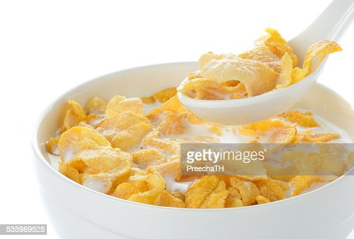 cornflakes and milk isolated on white : Stock Photo