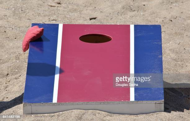 Cornhole board and bags on the beach