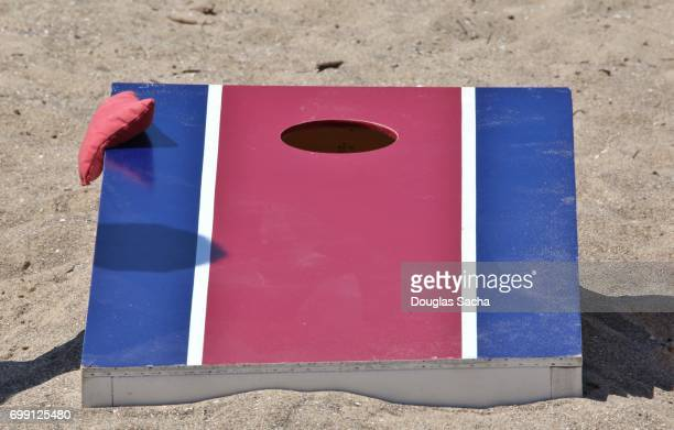 Cornhole game board and bags on the beach