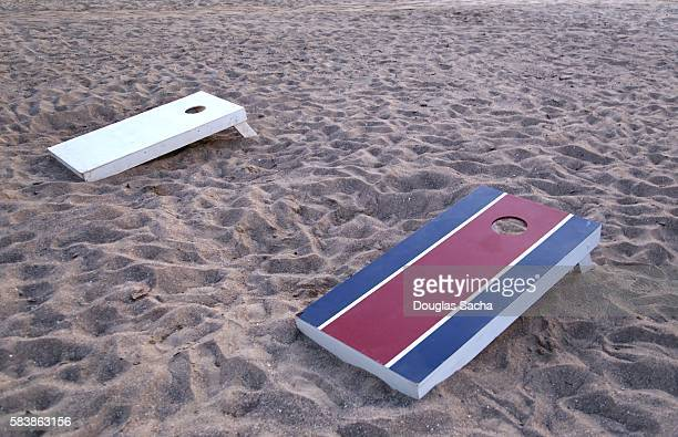 Cornhole game boards on the beach
