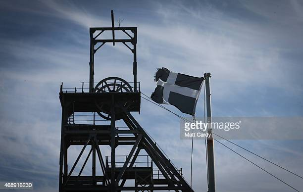 Cornish flag flutters besides the winding tower at Geevor Tin Mine near St Ives on April 8 2015 in Cornwall England Prime Minister David Cameron has...