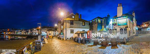 Cornwall harbour pubs restaurants illuminated dusk panorama St Ives UK