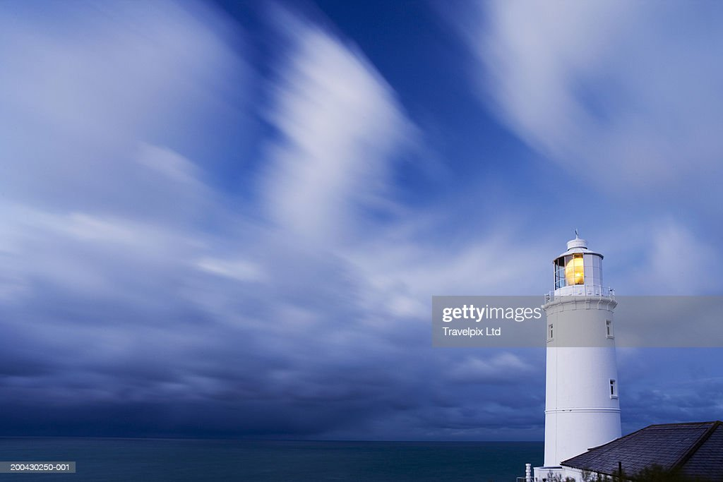 UK, Cornwall, Trevose Head lighthouse illuminated under cloudy sky : Stock Photo