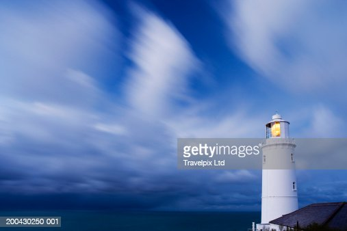 UK, Cornwall, Trevose Head lighthouse illuminated under cloudy sky : Stock Photo