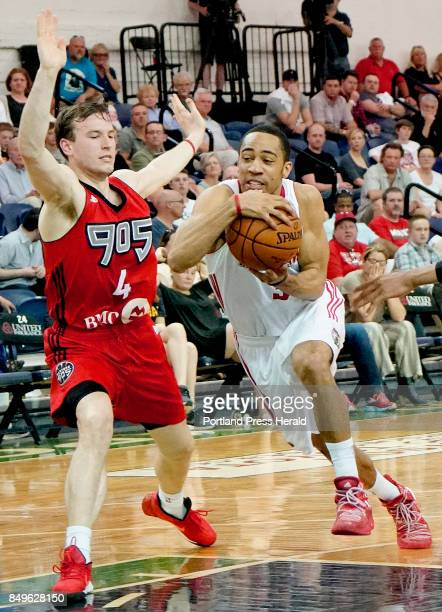 Coron Williams of the Maine Red Claws drives the lane against Brady Heslip of the 905 Raptors in a NBA DLeague playoff game Sunday April 16 2017