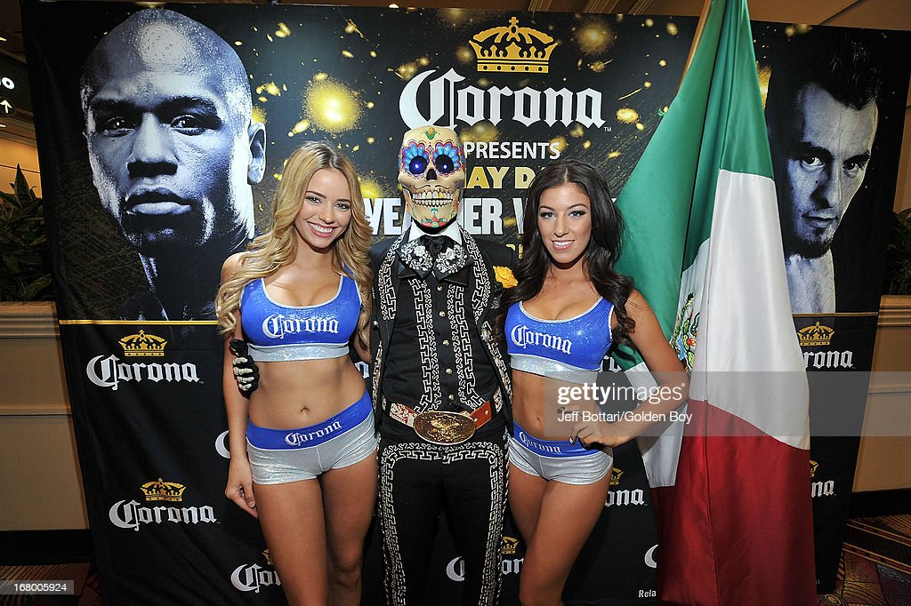 Corona girls pose outside the entrance for Floyd Mayweather Jr. and Robert Guerrero to weigh-in for their welterweight bout at the MGM Grand Garden Arena on May 3, 2013 in Las Vegas, Nevada. Mayweather will defend his WBC welterweight title against Guerrero.