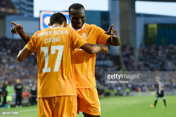 Corona of FC Porto celebrates with Aboubakar after scores the third goal during the PreSeason Friendly match between FC Porto and RC Deportivo La...