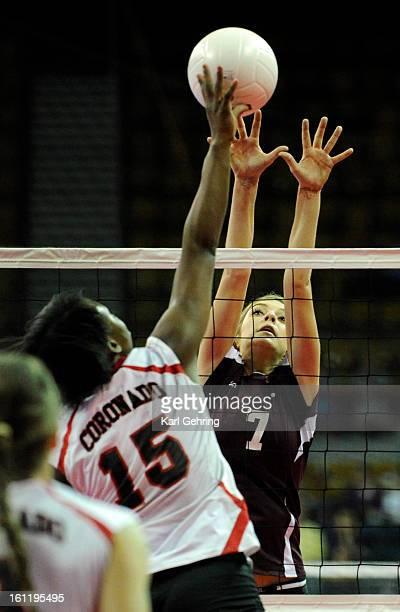 Coronado senior Latika Clanton pushed a shot over the arms of Cheyenne Mountain junior Monique Domme The Cheyenne Mountain High School volleyball...