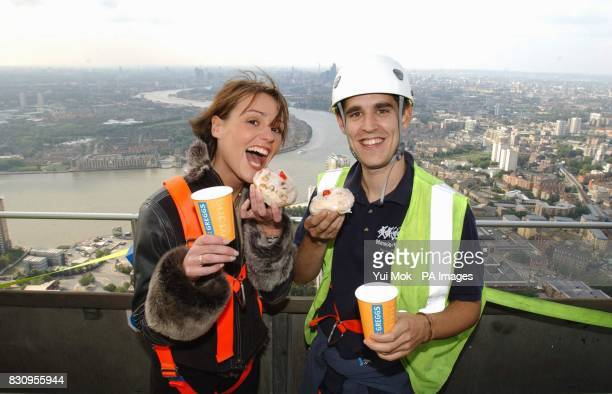Coronation Street actress Suranne Jones with Canary Wharf window cleaner Lee Snell aged 23 during a photocall to launch Children's Hospice Week...