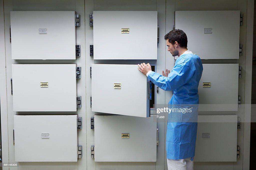Coroner Standing in Morgue