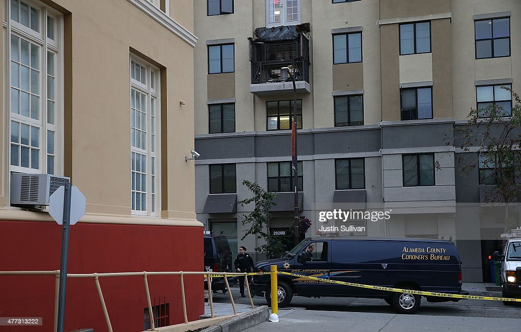 A coroner vehicle sits parked at the scene of a balcony collapse at an apartment building near UC Berkeley on June 16 2015 in Berkeley California 5...