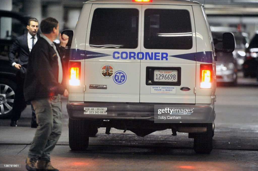 LA Coroners arrive and after time leave the Beverly Hilton Hotel possibly carrying the body of the singer Whitney Houston in the early hours of February 12, 2012 in Los Angeles, CA. Singer and film star Whitney Houston aged 48 has died in her hotel room at the Beverly Hilton Hotel.