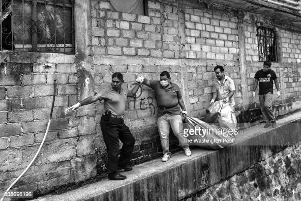 Coroners from the city of Acapulco remove a body from Barranca de la Laja an impoverished neighborhood in Acapulco Mexicoon July 20 2017 The body...