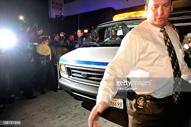Coroners leave the Beverly Hilton Hotel possibly carrying the body of the singer Whitney Houston in the early hours of February 12 2012 in Los...