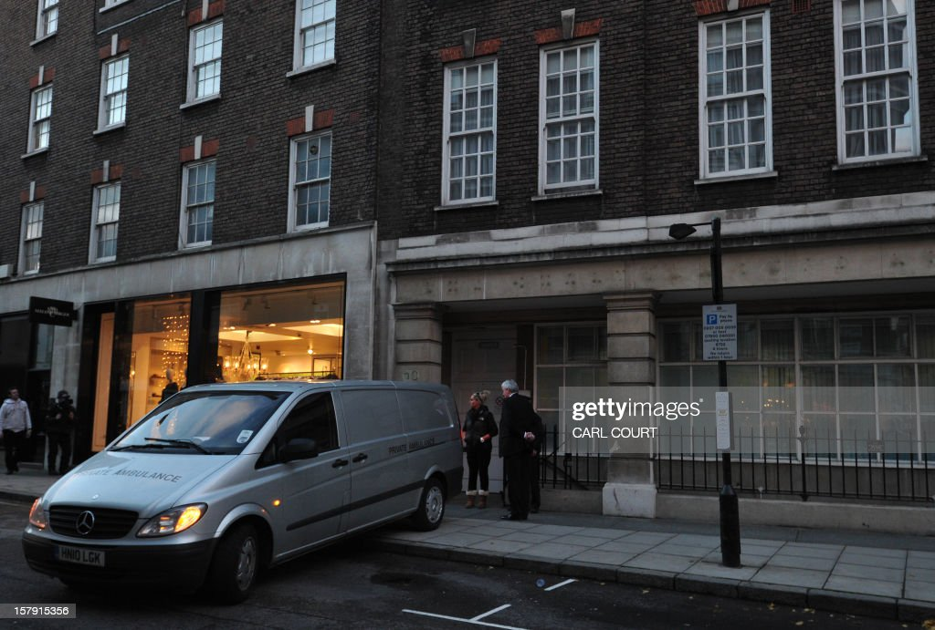 A coroners van waits outside a nurses accommodation block near the King Edward VII hospital in central London on December 7, 2012 where nurse Jacintha Saldanha was found dead. A nurse at the hospital which treated Prince William's pregnant wife Catherine, Duchess of Cambridge was found dead on December 7, days after being duped by a hoax call from an Australian radio station, the hospital said. Police said they were treating the death, which happened at a property near the hospital, as unexplained. AFP PHOTO / CARL COURT