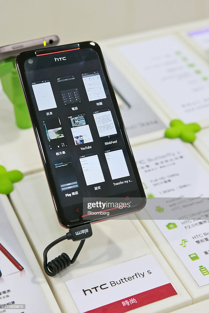 Corp. Butterfly S smartphone is displayed at one of the company's stores in Taipei, Taiwan, on Thursday, July 4, 2013. HTC is scheduled to announce second quarter earnings on July 8. Photographer: Maurice Tsai/Bloomberg via Getty Images