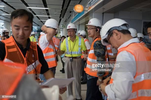 MTR Corp chairman Frederick Ma speaks with members of Hong Kong's Legislative Council during a tour of the GuangzhouShenzhenHong Kong Express Rail...