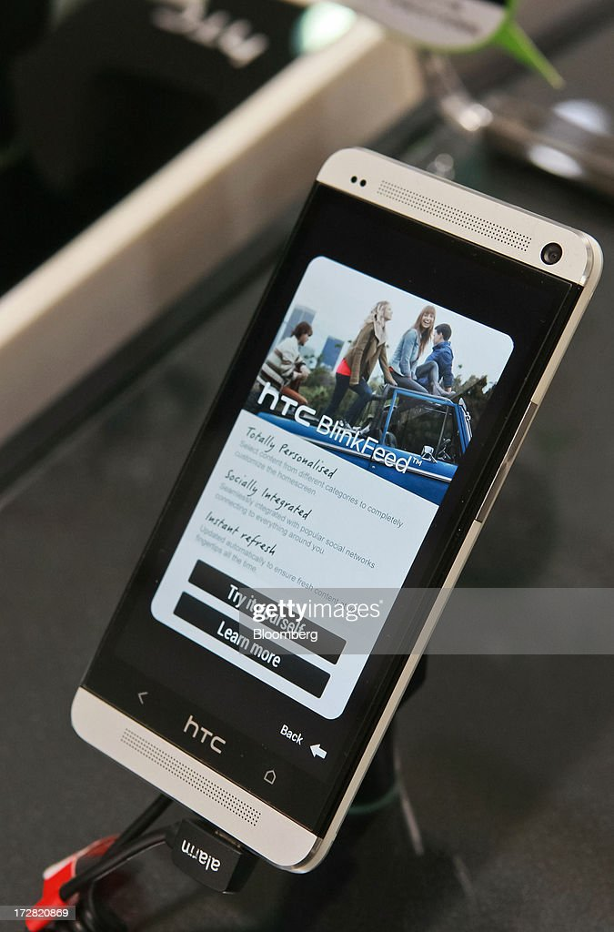 Corp. One smartphone is displayed at one of the company's stores in Taipei, Taiwan, on Thursday, July 4, 2013. HTC is scheduled to announce second quarter earnings on July 8. Photographer: Maurice Tsai/Bloomberg via Getty Images
