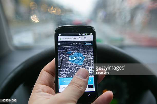 Corp smartphone displays a city map of Berlin in the driver's seat of an automobile in this arranged photograph in Berlin Germany on Monday Nov 24...