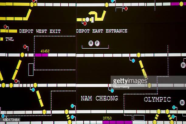 MTR Corp trains illustrated by numbers are displayed on a big screen inside the operations control center at Tsing Yi station in Hong Kong China on...