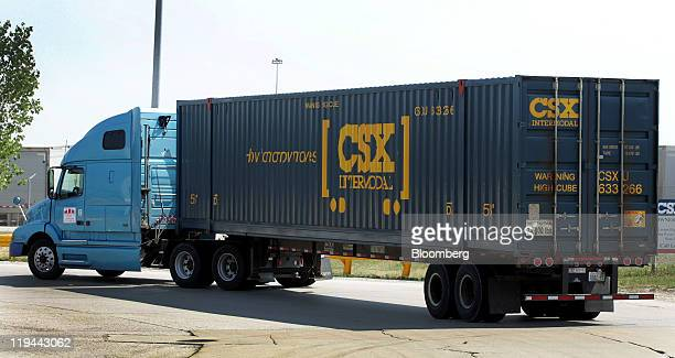 Corp truck enetrs the company's railroad yard in Bedford Park Illinois US on Tuesday July 20 2011 CSX Corp the biggest eastern US railroad posted...