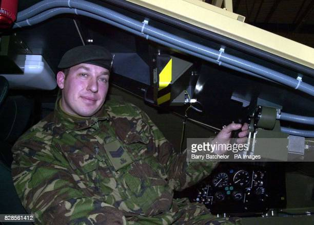 Corporal Barry Hope from Carterton Oxfordshire tries out one of the Combined Arms Tactical Trainer battlefield simulators during his visit to...