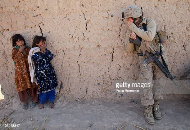 Corporal Catherine Broussard a US Marine with the FET 1st Battalion 8th Marines Regimental Combat team II tries to communicate with some Afghan girls...