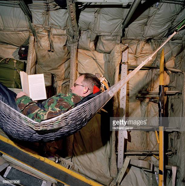 Corporal Chris Ward one of the photographers belonging to the elite 'Red Arrows' Britain's prestigious Royal Air Force aerobatic team reads a novel...