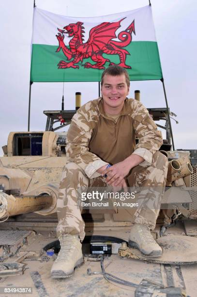 Corporal Dean John a vehicle mechanic from Port Talbot of 1st The Queen's Dragoon Guards sits on a Scimitar tank at Camp Bastion in Helmand...