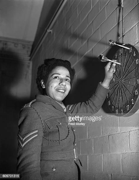 Corporal Hinds of the British Auxiliary Territorial Service playing darts at an ATS training centre in the UK 18th December 1942 Hinds who is...