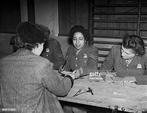 Corporal Hinds of the British Auxiliary Territorial Service registers new recruits to the service at a training centre in the UK 18th December 1942...