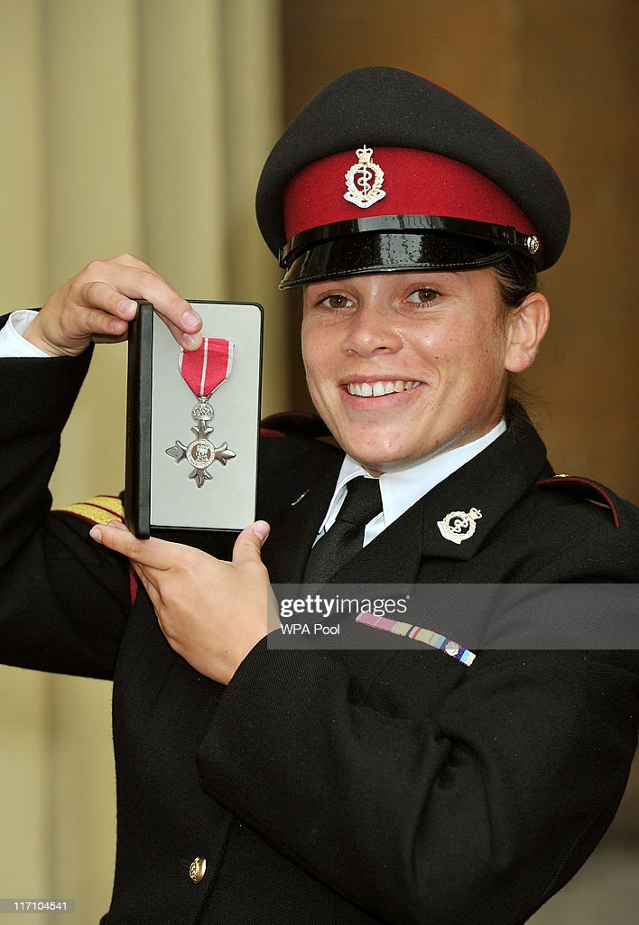 Corporal Isobel Henderson of the Royal Army Medical Corps holds her military division MBE, after it was presented to her by the Prince of Wales, at the Investiture Ceremony on June 23, 2011 at Buckingham Palace, London.
