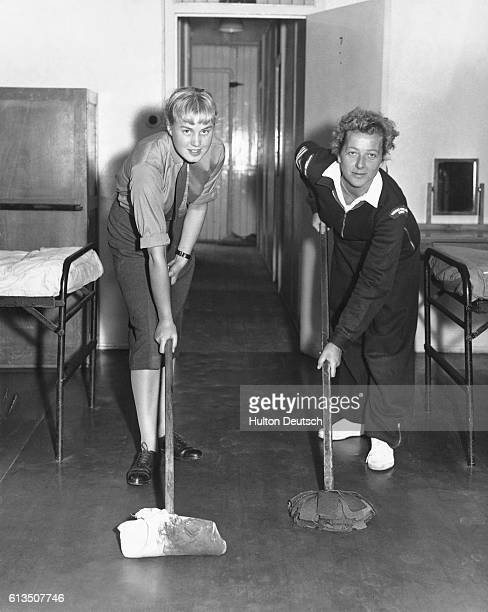 Corporal June Merrifield and Sergeant Grace Thompson polish the floors of the Women's Royal Army Corps barracks in London The barracks are to house...
