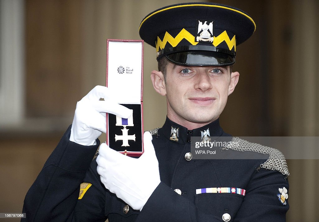 Corporal Keith Mitchell, Royal Scots Dragoon Guards, poses after being awarded the Military Cross , at Buckingham Palace on November 21, 2012 in London, England.