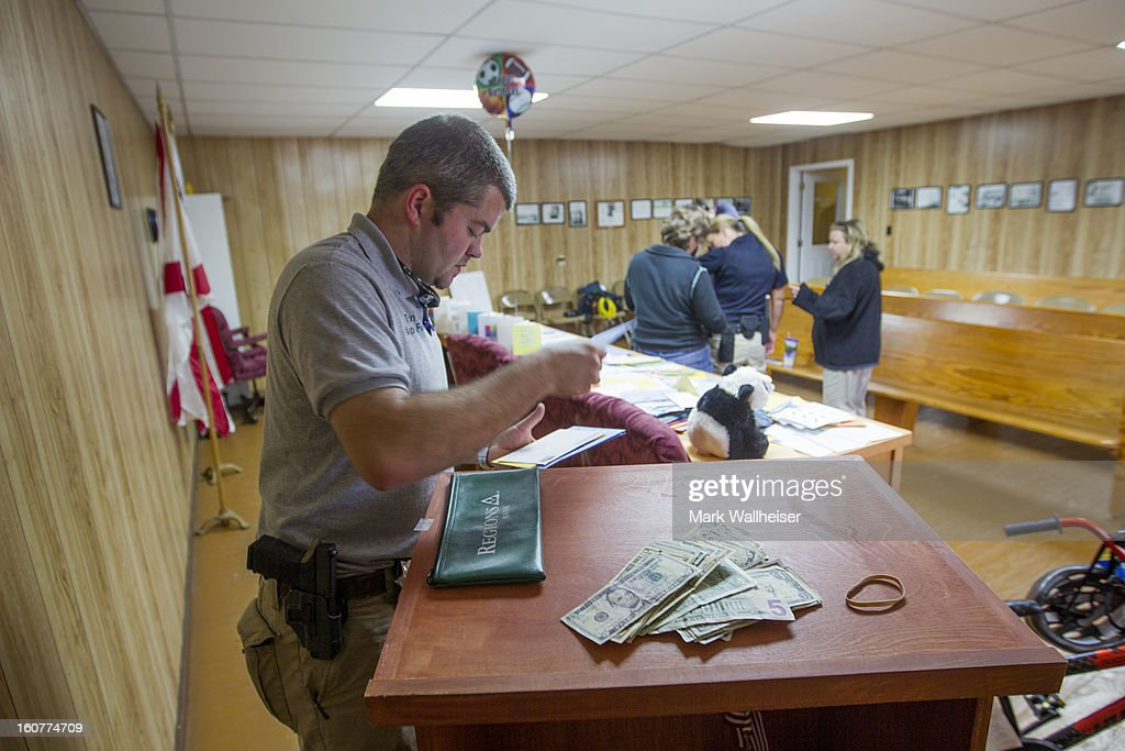 Corporal Shaun Cunningham, with the Napier Field Police Dept sorts birthday cards and collects money February 5, 2013 in Napier Field, Alabama for the 5 year-old boy named Ethan who was rescued by the FBI when they stormed the bunker where he'd been held captive for 6 days. The suspected gunman, Jimmy Lee Dykes, is dead.