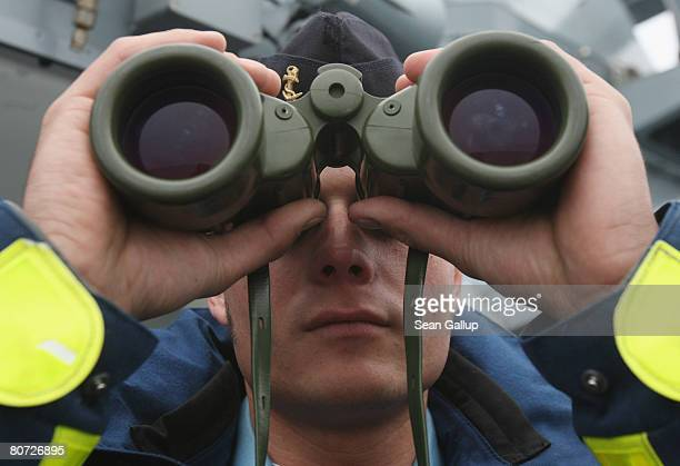 Corporal Tino Lingnau of the German navy mans the observation platform with binoculars on board the 'Braunschweig' corvette during a trip for the...