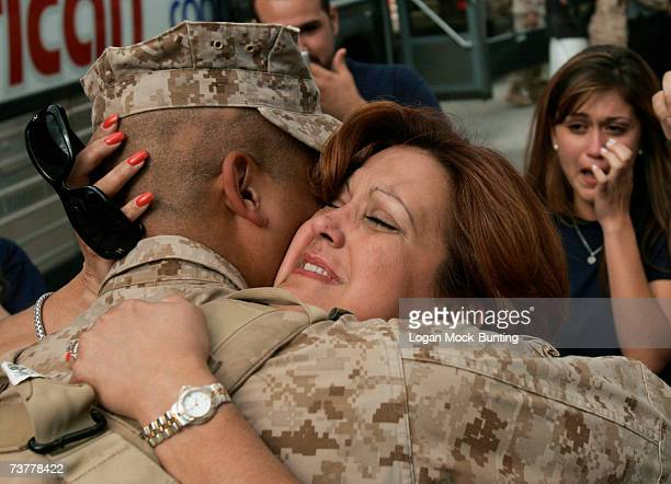 Corporal Ulysses Lopez of the 2nd Light Armored Reconnaissance Battalion is greeted by family and friends upon arriving on April 2 2007 in Camp...