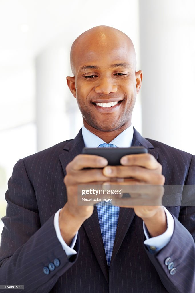 Corporate Executive Using Cell Phone : Stock Photo