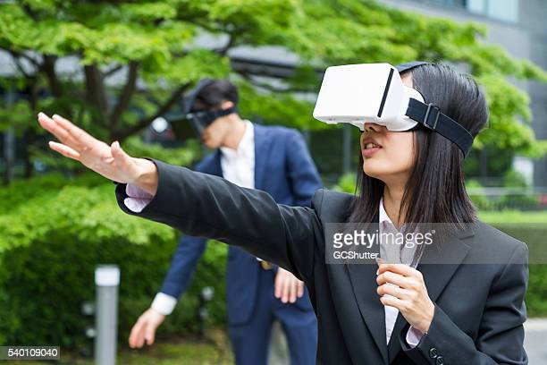 Corporate Executives Playing with Virtual Reality Consoles
